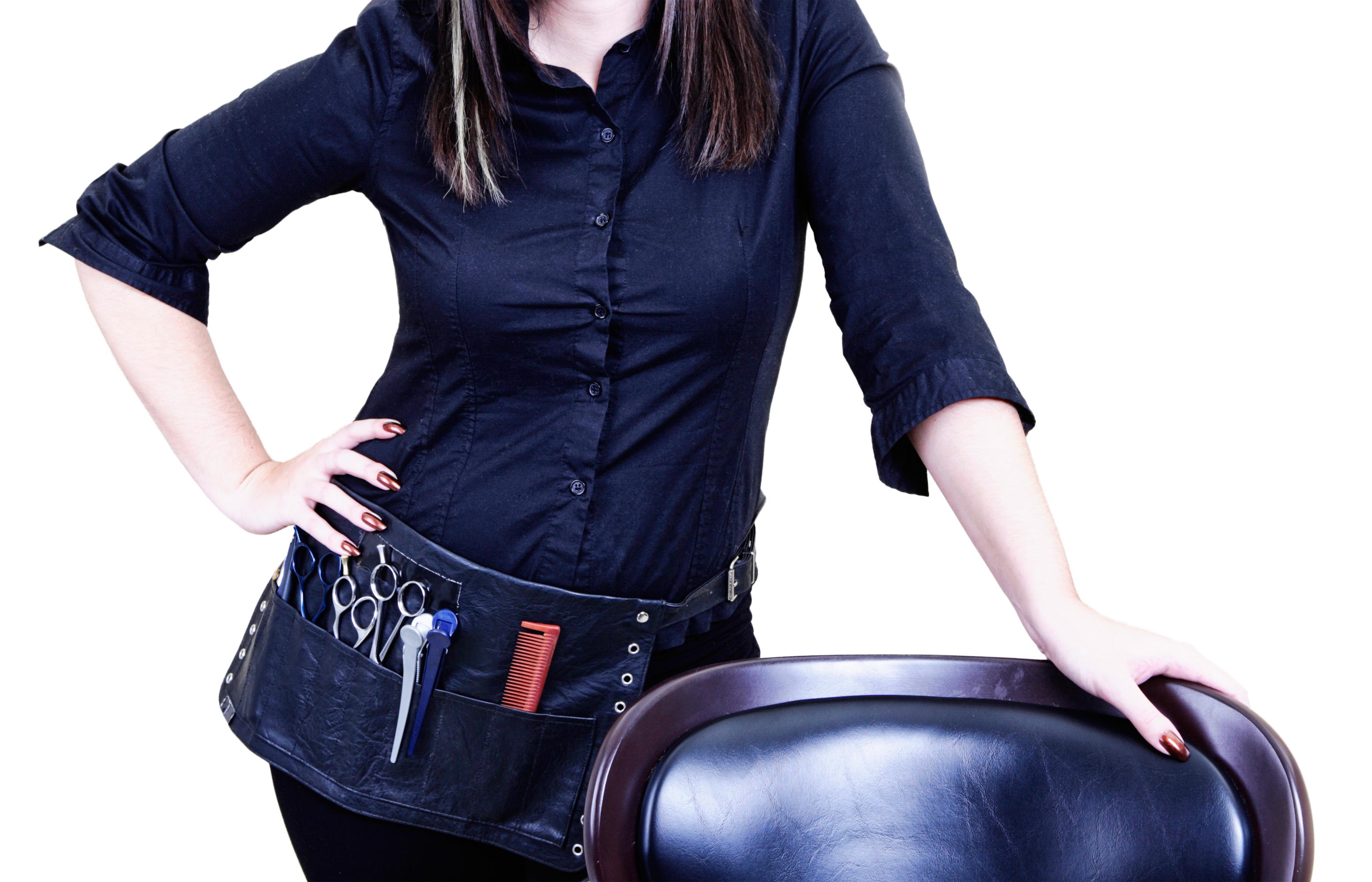 Hair stylist leaning on her salon chair with an apron full of hair cutting scissors and combs
